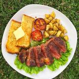 Grass-fed Ribeye steak with toast and Potato Cubes
